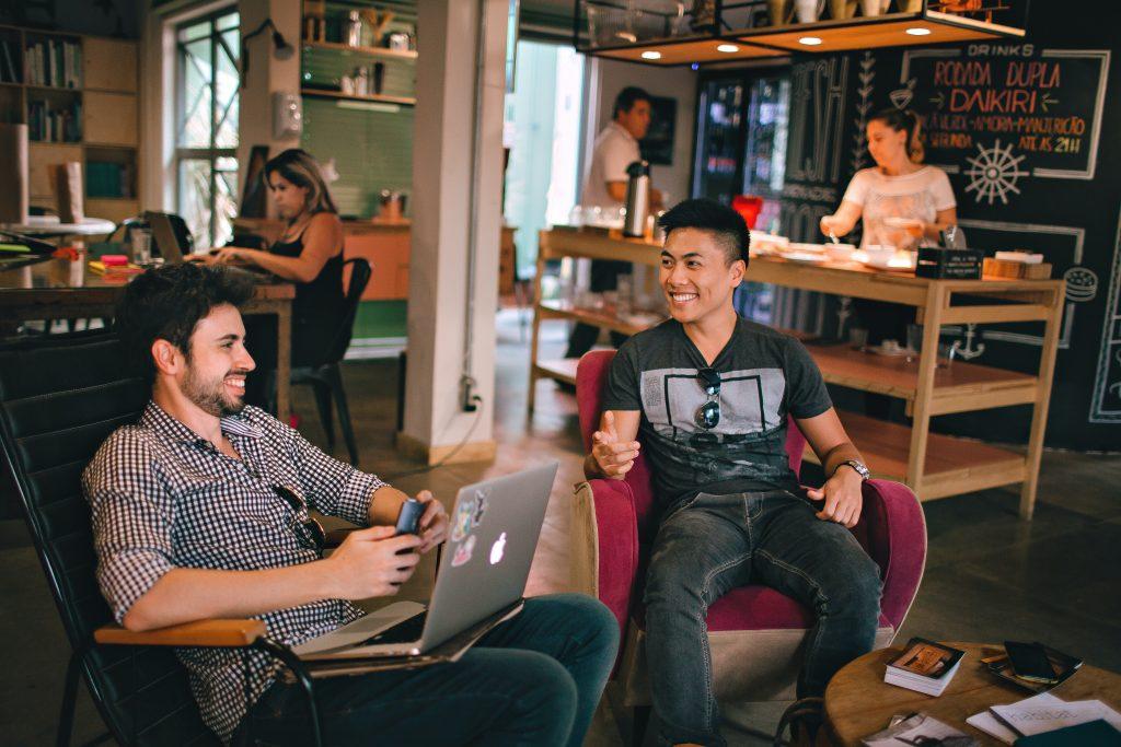 Men talking in a hostel